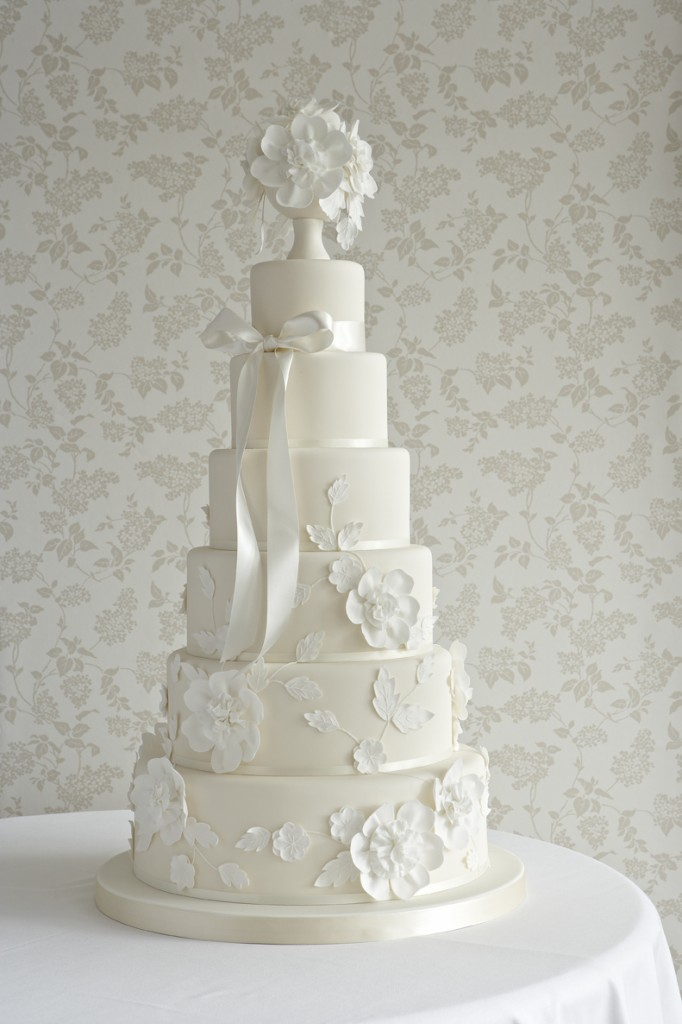 wedding cake with stylised ruffle flowers