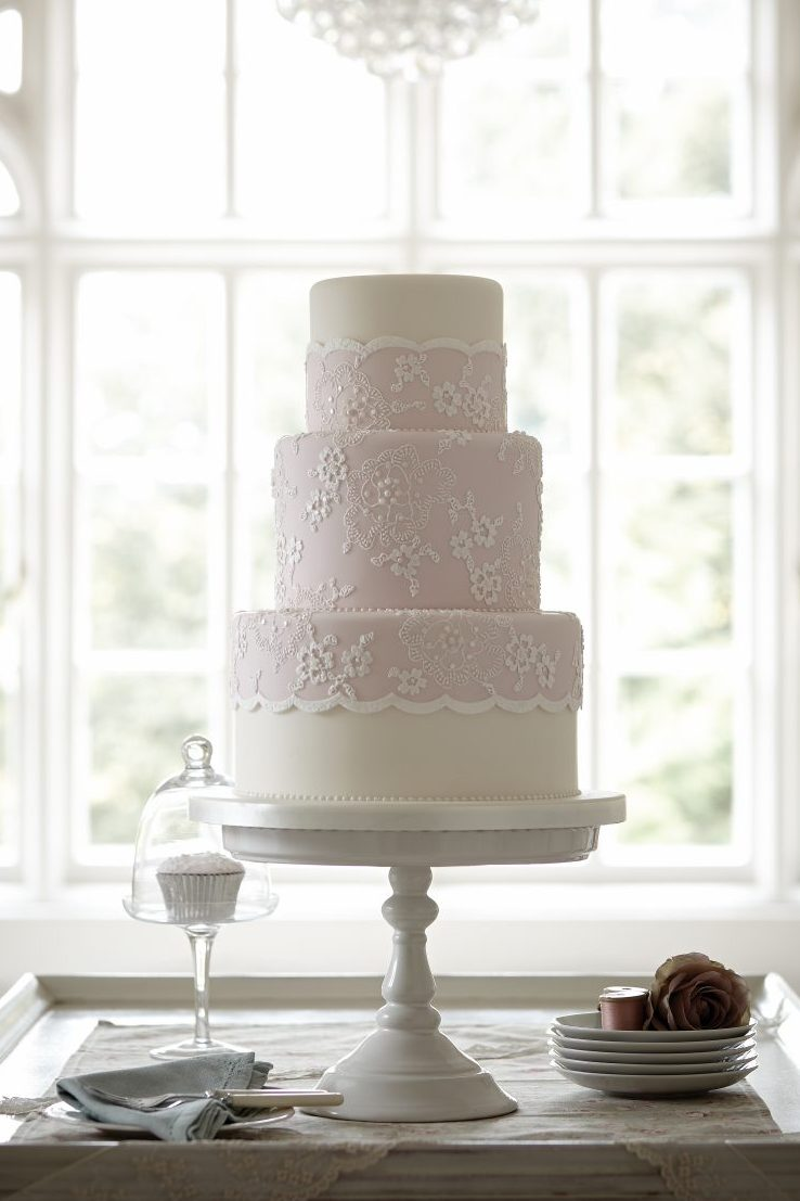 dusky pink wedding cake with lace