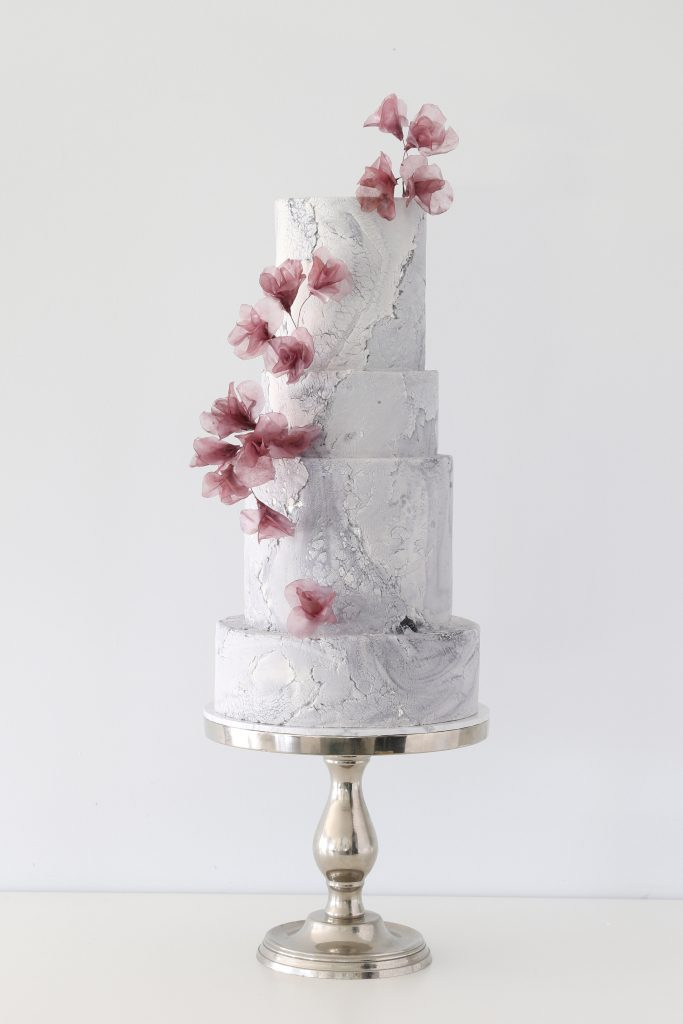 Rice paper flowers on an aged stone wedding cake Brisbane