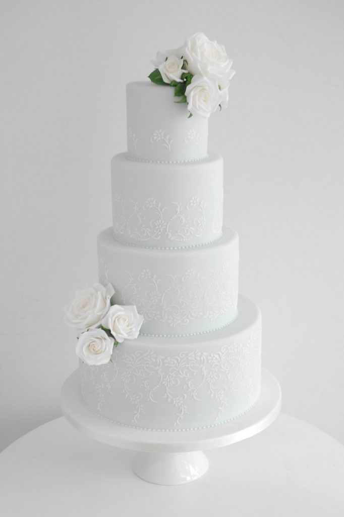 wedding cake with vintage stencil pattern and sugar roses