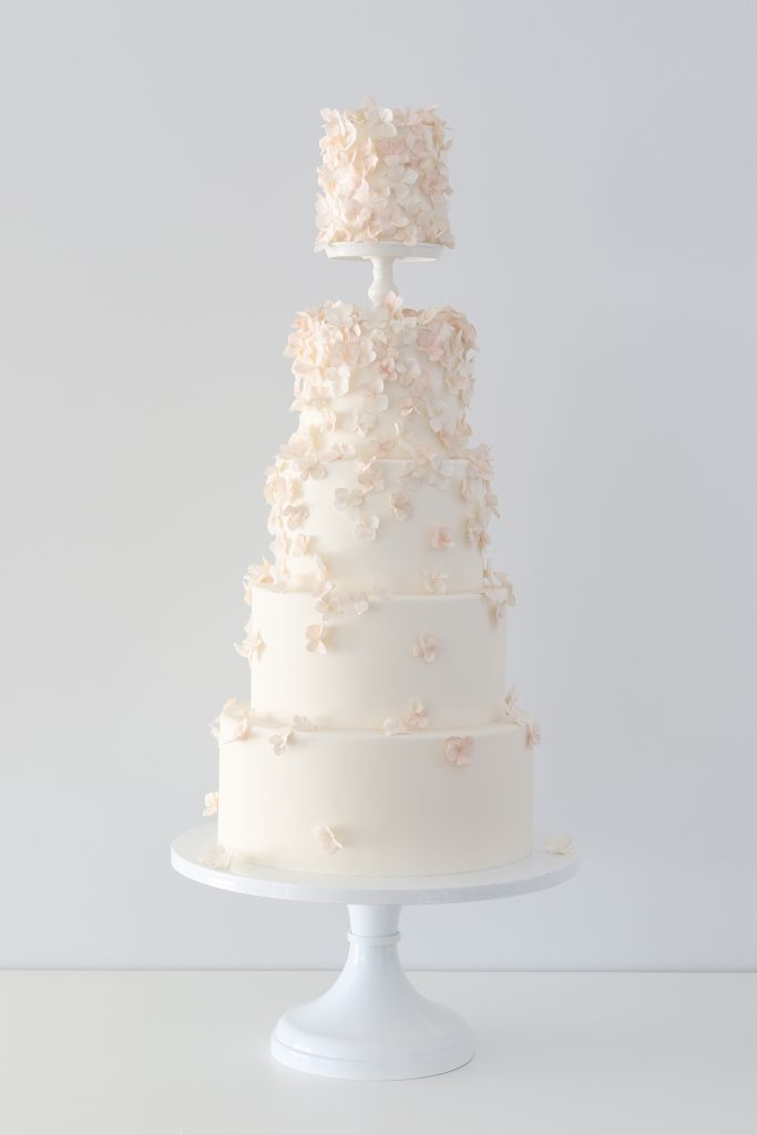 Peachy hydrangea wedding cake