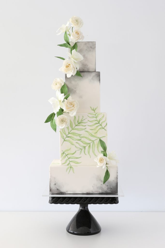 Painted wedding cake with tropical feel.