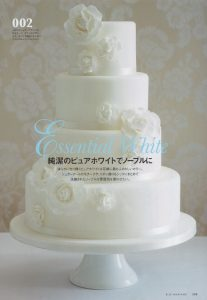 white rose corsage wedding cake in Elle Japan