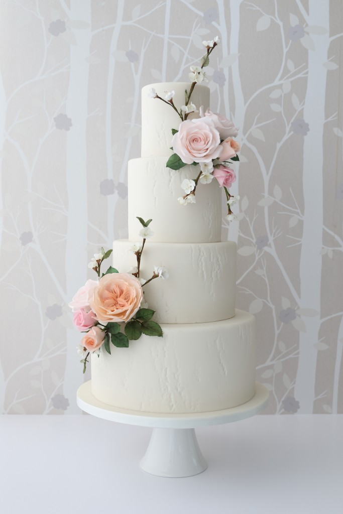 Sugar roses and blossom wedding cake