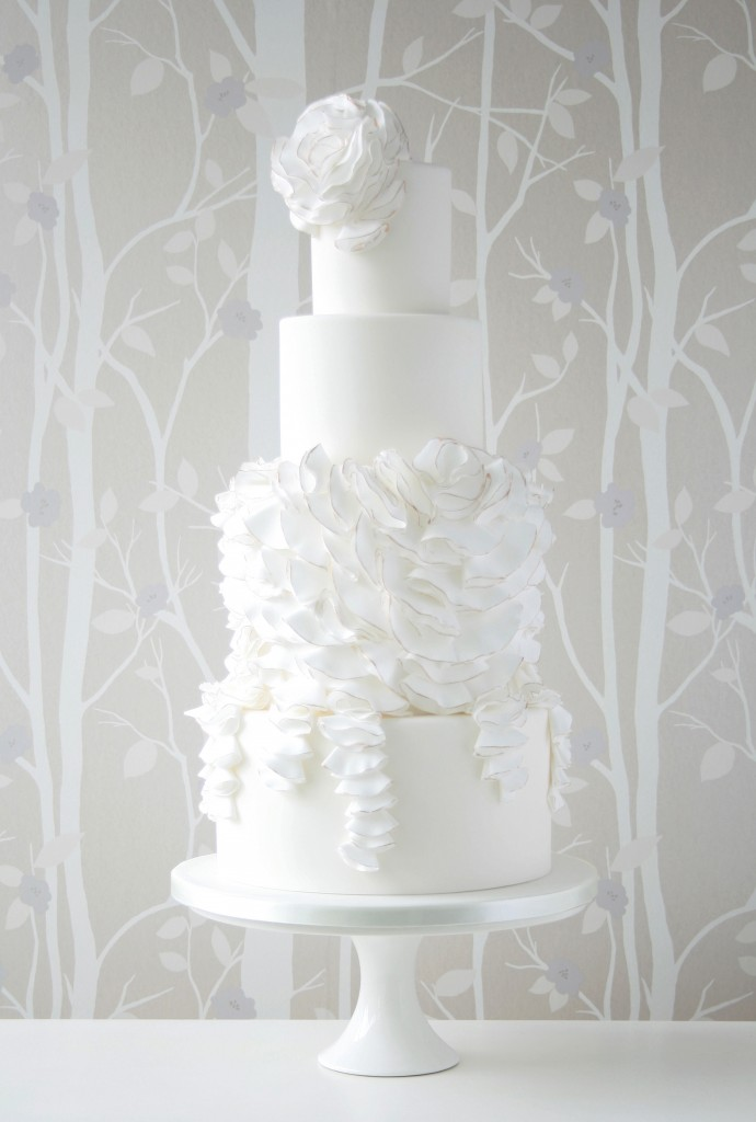 Folded ruffles white wedding cake