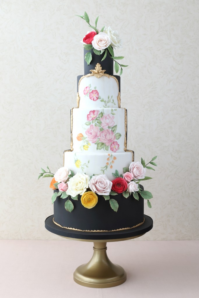 Painted rose and sugar rose iced wedding cakes
