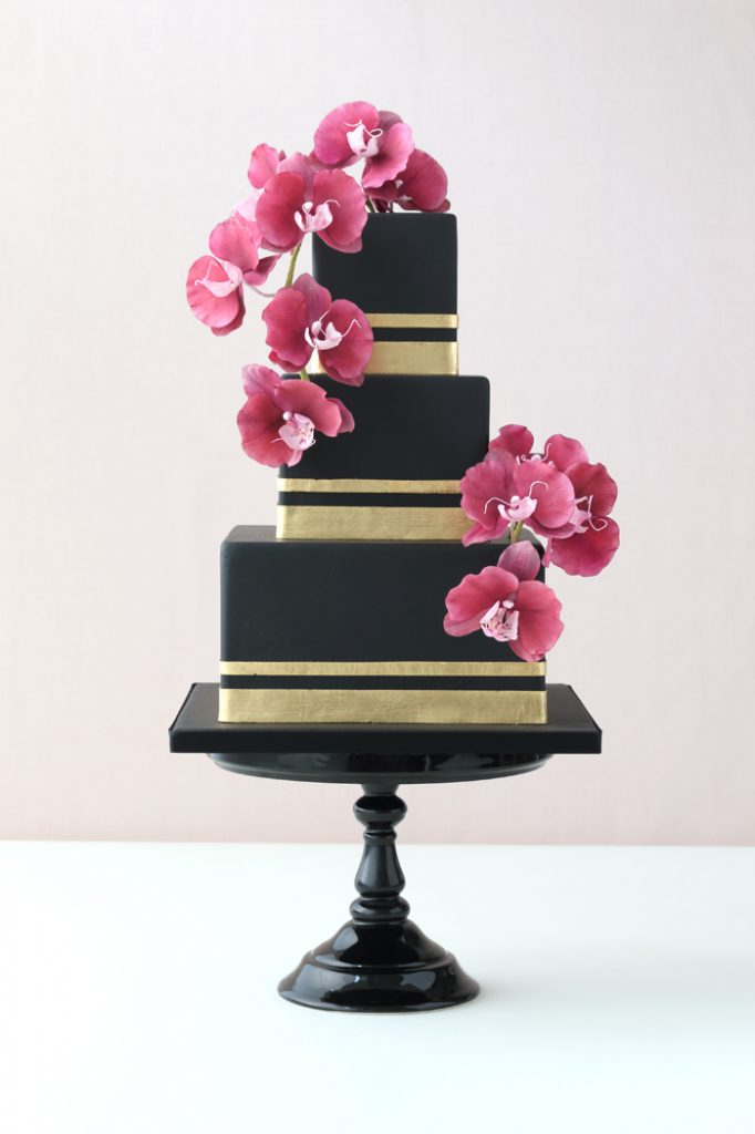 Sugar orchid and gold leaf wedding cake