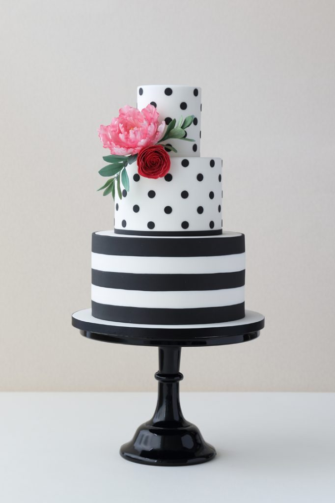 Stripy parrot tulip and ranunculus wedding cakes