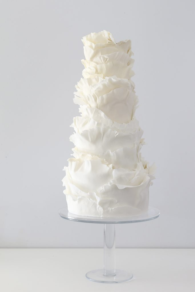 torn paper ruffles wedding cake