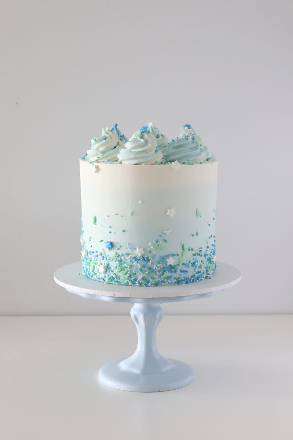 Sprinkles and kisses buttercream cake